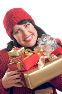Attractive Woman Holds Holiday Gifts Isolated on a White Background.