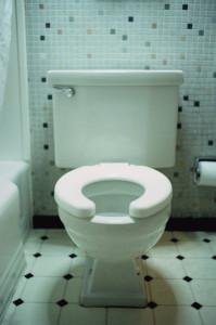 ca. 2002 --- Motel Room Toilet --- Image by © Royalty-Free/Corbis